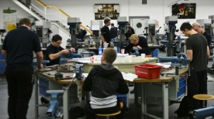 Apprentices are trained at the Lufthansa Technik training center in Hamburg last month. About 60 percent of German high school students opt for vocational training over further academic education.